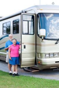 Happy retired couple that got their RV/Motor Home towed